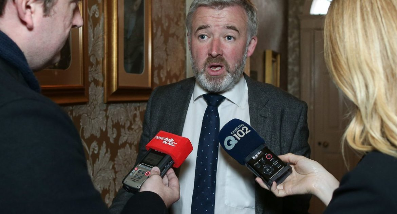 Liam Herrick speaking to journalists