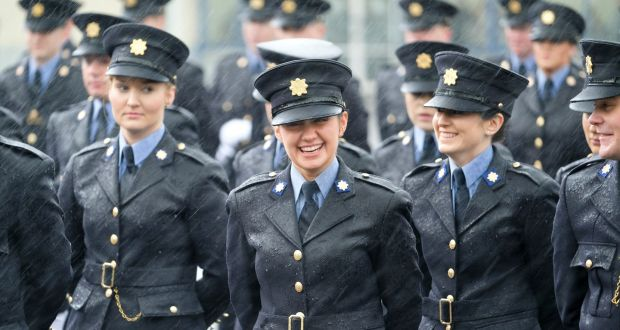 female garda recruits smiling