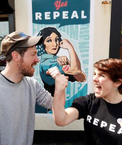 Artist Gearóid Seoighe AKA Giant Sigh with ICCL comms officer Sinéad Nolan in front of ICCL mural 'Rosaleen the Repealer'