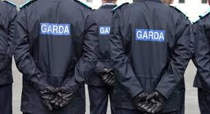 two gardai seen from the back