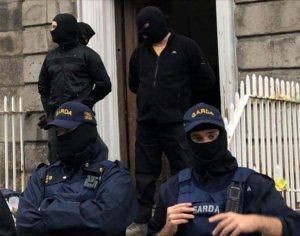 Masked Gardai assist unidentified men in balaclavas to carry out an eviction